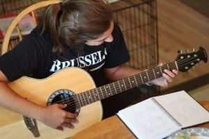 What's Your Family Culture? - Ann Kroeker - girl learns guitar