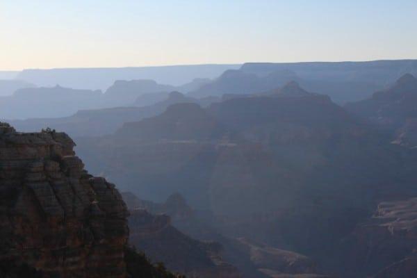 grand canyon setting sun haze