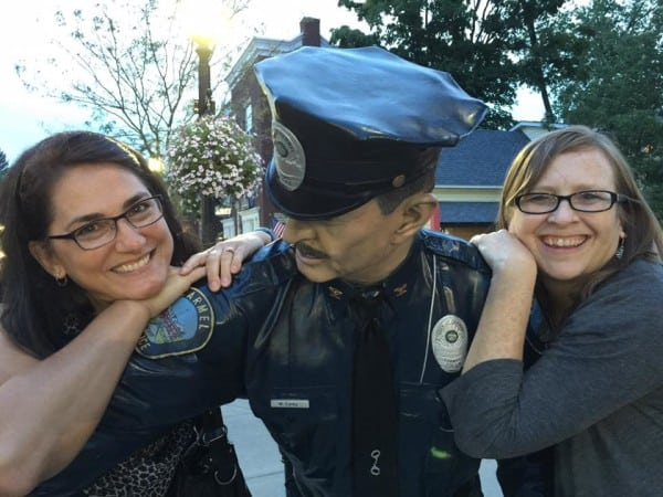 ann and charity with policeman sculpture