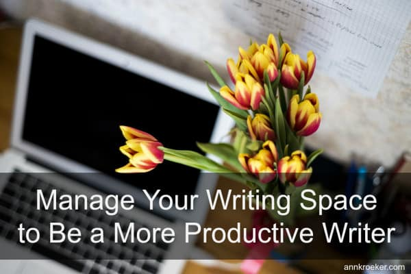 yellow tulips next to laptop - Manage Your Writing Space to Be a More Productive Writer